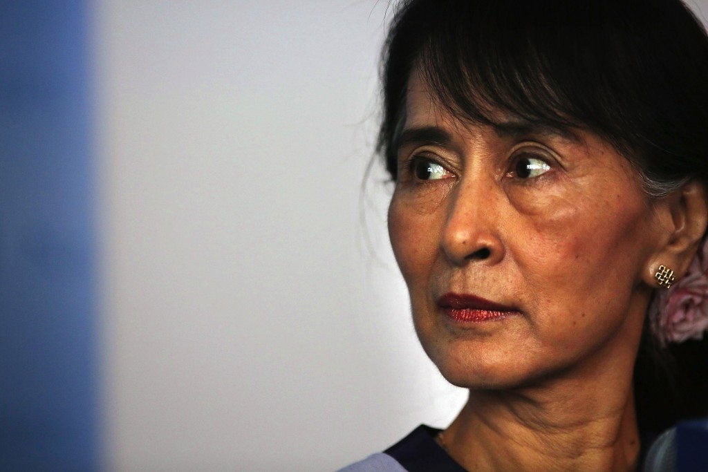 Burmese opposition leader Aung San Suu Kyi speaks to the media following a meeting with United Nations Secretary-General Ban Ki-Moon at the U.N. on September 21, 2012 in New York City. Photograph by Spencer Platt | Getty Images.