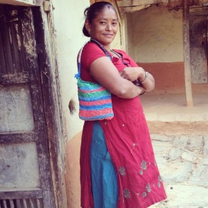 Woman in Nepal showing one of the bags made by Walden's social enterprise Trashé| Picture by Cara Walden