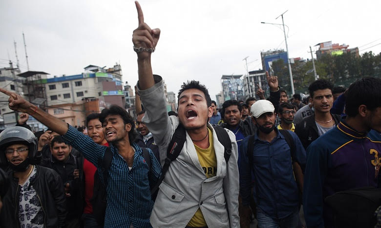 Dozens of people have blocked traffic and shouted slogans against the government after being denied space on free buses out of Kathmandu. Picture by Niranjan Shrestha | AP