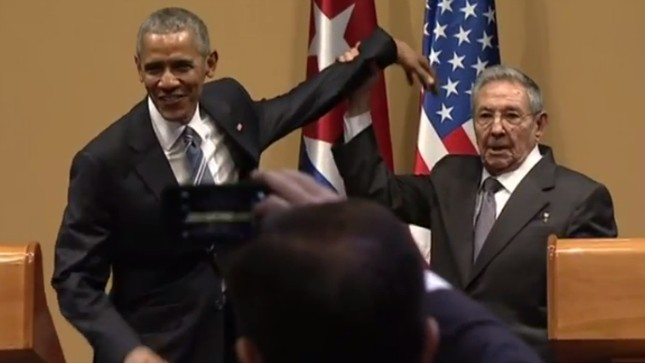 Cuban President Raul Castro, right, lifts up the arm of President Barack Obama at the conclusion of their joint news conference at the Palace of the Revolution, Monday, March 21, 2016, in Havana, Cuba. Picture by Ramon Espinosa | Associated Press.