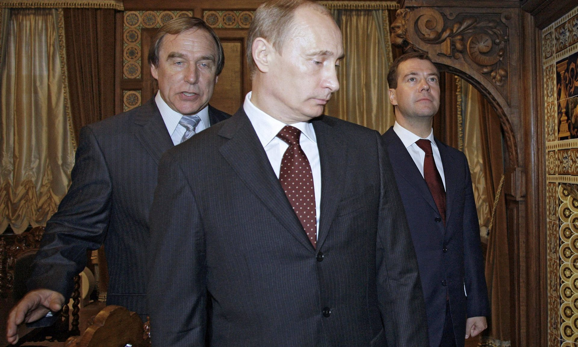 Sergei Roldugin, Vladimir Putin and Dmitry Medvedev, then Russian president, tour the House of Music in St Petersburg in 2009. PIcture by Dmitry Astakhov | Sputnik/Kremlin Pool/EPA
