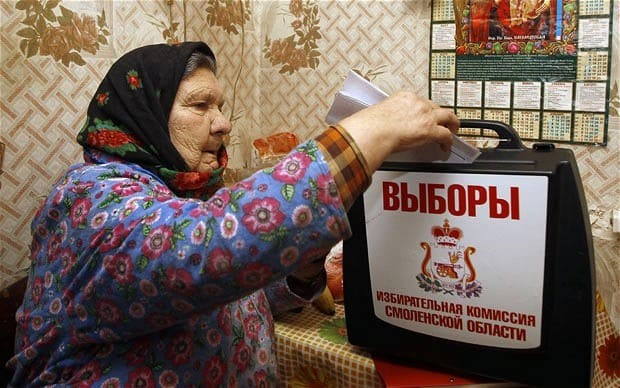 Yevdokia Knyazeva votes at her home in the village of Oster, 380 kilometers (237 miles) west of Moscow Photo: AP Photo/Sergei Grits via telegraph.co.uk